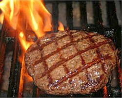 A juicy GSI Angus steak patty grilling on the barbecue... there's nothing quite like it! Order yours today!