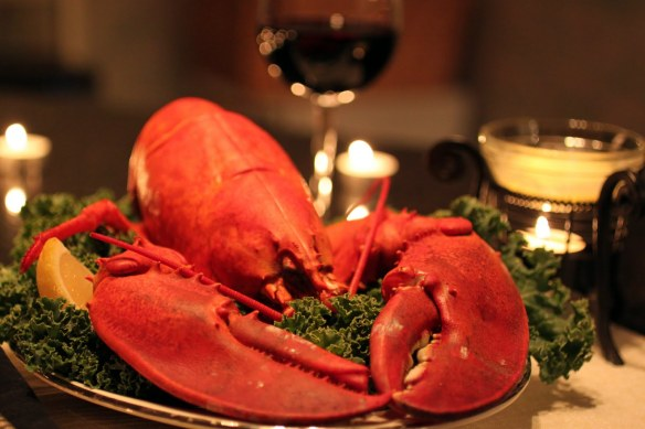 A big red cooked lobster on a garnished plate, a welcome sight! Gourmet Secrets can make it happen!